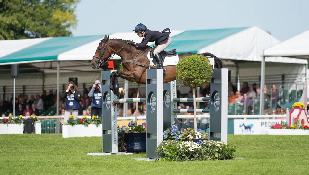 Rosalind Canter (GBR) and  Allstar B competing in the  Show Jumping competition  of the Land Rover Burghley  Horse Trials on Sunday 6th September 2015 in Stamford, Lincolnshire, England